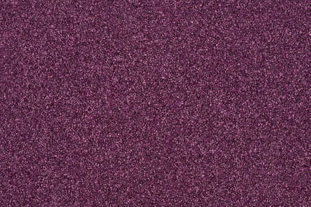 Background made of purple decorative sand.  photo