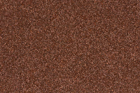 Background made of brown decorative sand.  photo