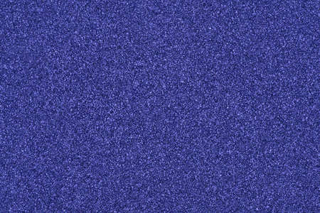 Background made of blue decorative sand.  photo