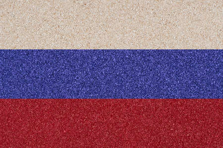 Flag of the Russian Federation made of colored decorative sand. photo