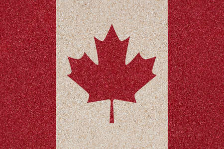 Flag of Canada made of colored decorative sand  photo