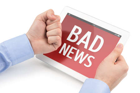 Mans hands threatening at the tablet computer screen on which displays the bad news message, isolated on a white background  Stock Photo