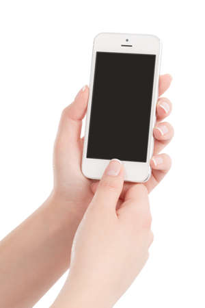 Female hands holding white modern smart phone with blank screen and pressing button by the thumb. Isolated on white background.  photo