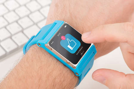 wristlet: Male finger taps like icon on blue smart watch
