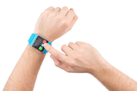 Male finger taps on the screen of the smart watch
