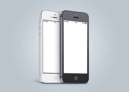 half turn: Black and white smartphones are close to each other in half turn and rotated at a slight angle on gray gradient background.  Stock Photo