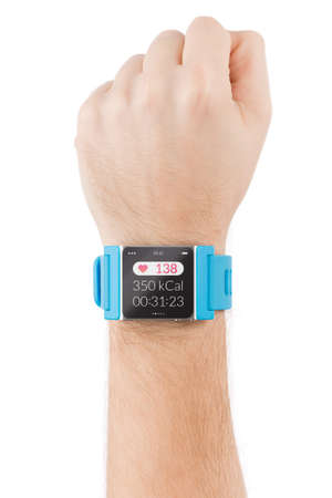 Male hand with smart watch with heart beat on the screen is raised to the sky  photo