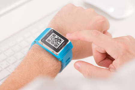 response: Man is scanning quick response code with blue smart watch