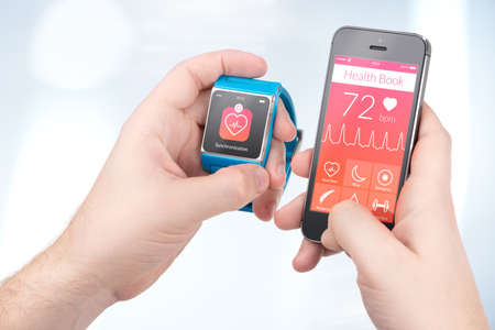 Data synchronization of health book between smartwatch and smartphone in male hands photo