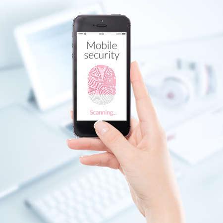 scanning: Woman hand is scanning fingerprint by modern black smartphone. Mobile security concept.