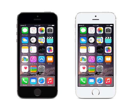 Varna, Bulgaria — December 08, 2013: Apple Space Gray and Silver iPhone 5S displaying iOS 8, mobile operating system, designed by Apple Inc. Isolated on white background.