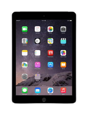 Varna, Bulgaria - February 02, 2014: Apple Space Gray iPad Air 2 with touch ID displaying iOS 8 homescreen, designed by Apple Inc. Isolated on white background. High quality. Redakční