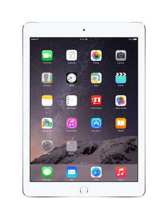 to white: Varna, Bulgaria - February 02, 2014: Front view of Apple Silver iPad Air 2 with touch ID displaying iOS 8 homescreen, designed by Apple Inc. Isolated on white background. High quality. Editorial