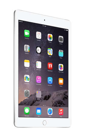 air: Varna, Bulgaria - February 02, 2014: Half turned Apple Silver iPad Air 2 with touch ID displaying iOS 8 homescreen, designed by Apple Inc. Isolated on white background.  The whole image in focus. High quality. Editorial