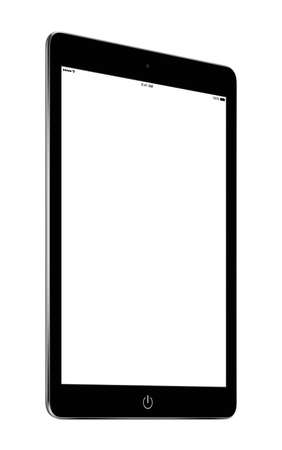 Bottom up view of rotated at a slight angle black tablet computer with blank screen mockup isolated on white background. High quality. Stock Photo