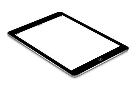 Black tablet computer with blank screen mockup lies on the surface, isolated on white background. Whole image in focus, high quality. Stock Photo