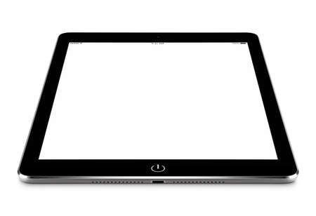 Angled front view of black tablet computer with blank screen mockup on the surface, isolated on white background. Stock Photo