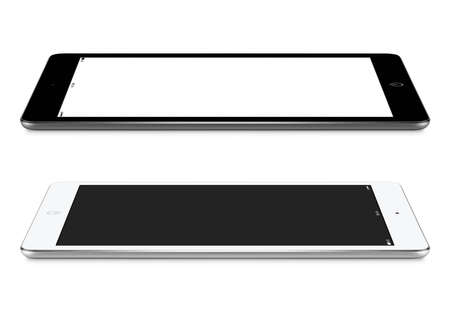 Black and white  tablet computers with blank screen mockup lie on the surface, left and right side view, isolated on white background.