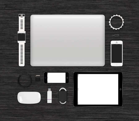 surface view: Top view of branding identity technology gadgets mockup for design presentation or portfolio on black desk surface. Template includes tablet computer, smart watch, smartphones, laptop, computer mouse.