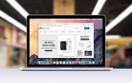 ebay: Varna Bulgaria  November 03 2013: Directly front view of Apple 15 inch MacBook Pro Retina with an open tab in Safari which shows Ebay web page. Blurred shopping center space on the . Editorial
