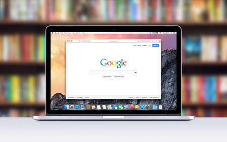 Varna Bulgaria  November 03 2013: Directly front view of Apple 15 inch MacBook Pro Retina with an open tab in Safari which shows Google search web page. Blurred bookshelves on the . Editoriali
