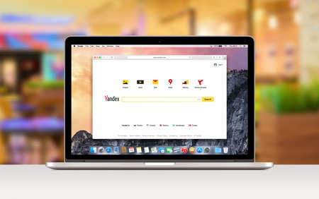 Yandex search web page in Safari browser on the Apple 15 inch MacBook Pro Retina screen. Blurred office space : Varna, Bulgaria - November 03, 2013