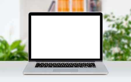 Front view of modern laptop mockup with white blank screen on the office desk. Office space on the background.