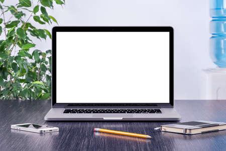 Laptop computer mockup with blank screen on office wooden desk. For design presentation or portfolio. All gadgets in full focus. Standard-Bild