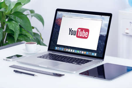 YouTube logo on the Apple MacBook Pro Retina display. YouTube presentation concept. YouTube is a video-sharing website allows users to upload, view, and share videos. Varna, Bulgaria - May 29, 2015.