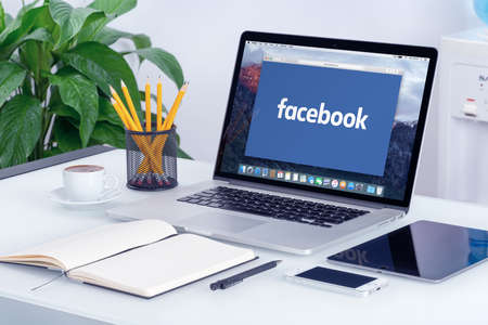 Facebook new logo on the Apple MacBook Pro Retina with an open tab in Safari browser that is on office desk. Facebook is the most popular social network in the world. Varna, Bulgaria - May 29, 2015. Editorial