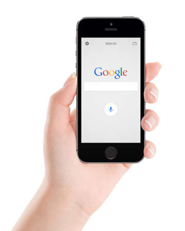 handoff: Google search application on the black Apple iPhone 5s display in female hand. Isolated on white background. Varna, Bulgaria - February 02, 2015.