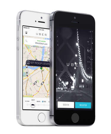 5s: Varna, Bulgaria - May 26, 2015: Uber app startup page and Uber search cars map on the angled front view white and black Apple iPhones 5s. Isolated on white background.