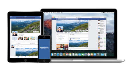 Facebook website on the Apple Macbook Pro display and Facebook apps on the iPad Air 2 and iPhone 5s screens. Isolated on white background. High quality. Varna, Bulgaria - February 02, 2015. Redakční