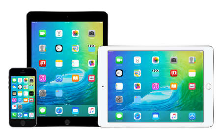 Apple iPhone 5s and two Apple iPad Air 2 in portrait and landscape orientation with announced on WWDC 2015 iOS 9 on the displays, designed by Apple Inc. High quality. Bulgaria - February 02, 2015. Editorial