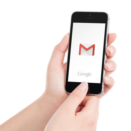 google: Varna, Bulgaria - May 31, 2015: Black Apple iPhone 5s with Google Gmail app logo on the display in female hands. Gmail is a most popular free Internet e-mail service provided by Google. Editorial