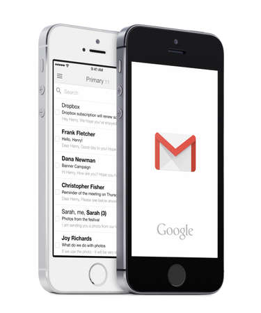 Varna, Bulgaria - May 26, 2015: Google Gmail app logo and Gmail inbox on the white and black Apple iPhones. Gmail is a free e-mail service provided by Google. Isolated on white background.