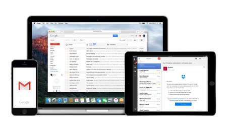 Varna, Bulgaria - February 02, 2015: Google Gmail app on the Apple iPhone iPad displays and desktop version of Gmail on the Macbook Pro. Gmail is a free e-mail service. Multiple devices kit. 新闻类图片