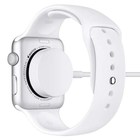 inductive: Varna, Bulgaria - October 16, 2015: Charging of Apple Watch Sport 42mm Silver Aluminum Case with White Sport Band. Back view fully in focus. Isolated on white background.