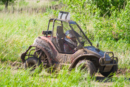 fourwheeldrive: Competition. Buggy racing on a dirt road. Stock Photo