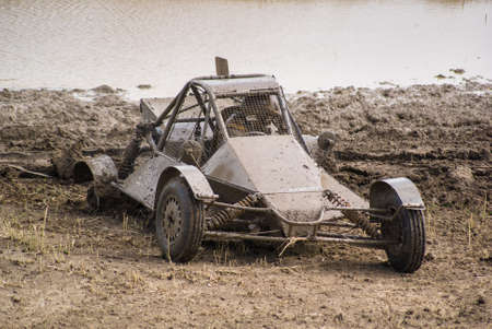 Competition. Buggy racing on a dirt road. Stock Photo