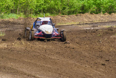 fourwheeldrive: Competition. Buggy racing on a dirt road. Dirt from the wheels.