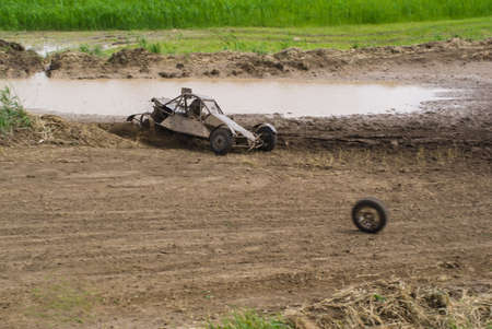 Competition. Buggy racing on a dirt road. Dirt from the wheels.