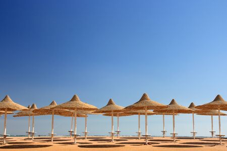 blue sky and umbrellas on the beach Stock Photo