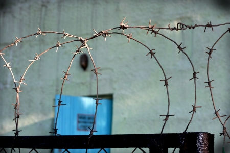 The barbed wire fence in russian prison  photo