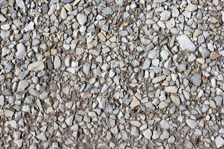 Background with small stones. Mountain road.  Stock Photo