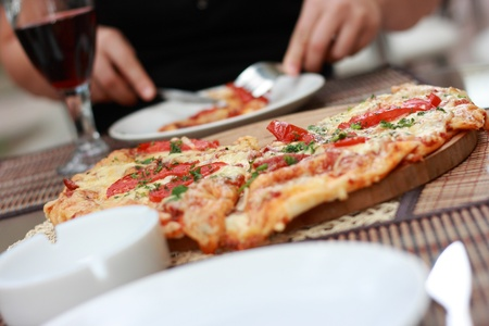 Pizza on the table in italian restautant  Stockfoto