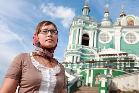 Faith in God gives me confidence in my life  Woman against the temple  Stock Photo