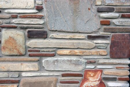 Stone background The wall from different stones, small and big