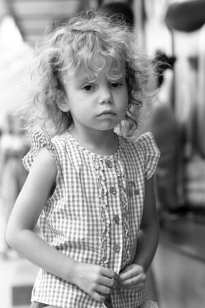 Girl 3 years with curly hair outdoors  photo