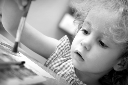 Creative little girl draws  Budding artist  photo